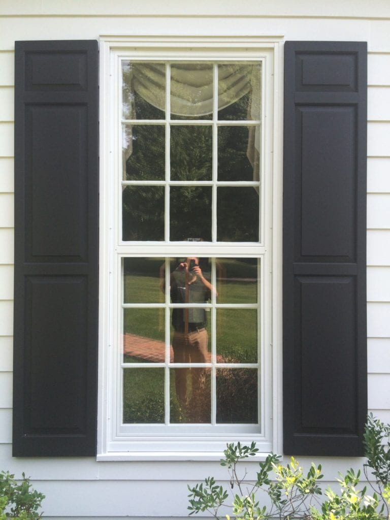 white trimmed windows with black shutters